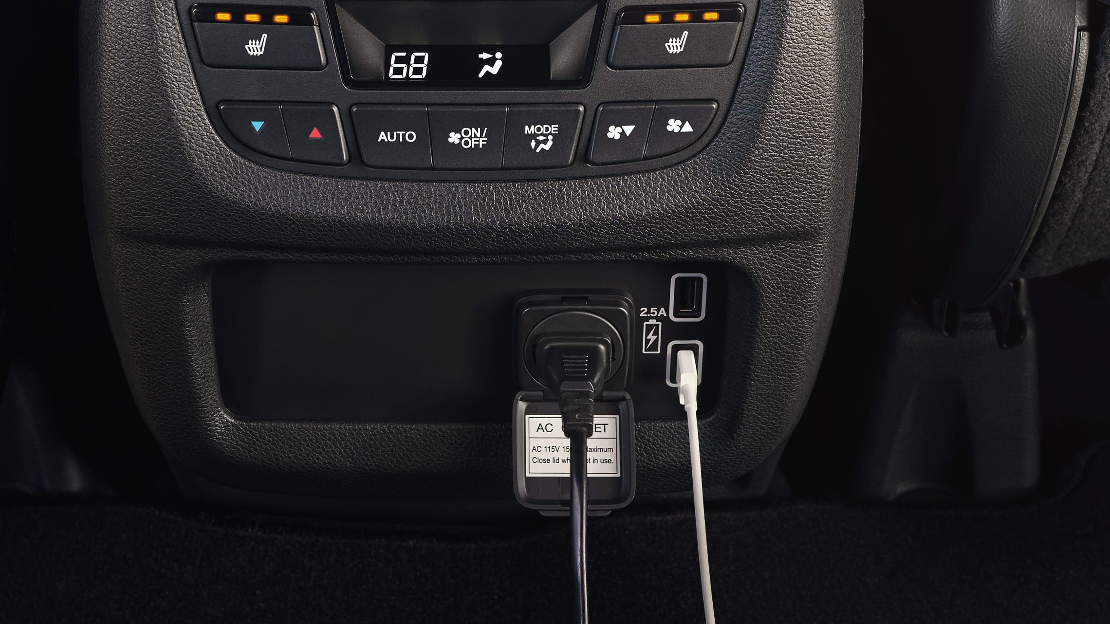 Interior view of 180-watt max power/120-volt AC power detail on the 2019 Honda Passport.