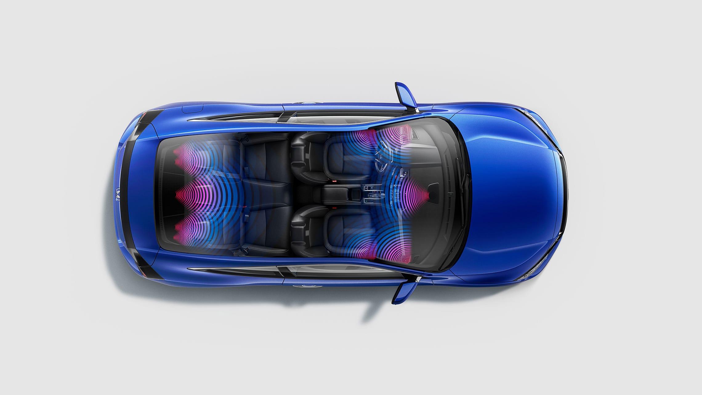Vista interior aérea del Honda Civic Touring Coupé 2020 con ondas de sonido ilustradas que muestran el sistema de audio de alta calidad con 10 bocinas.