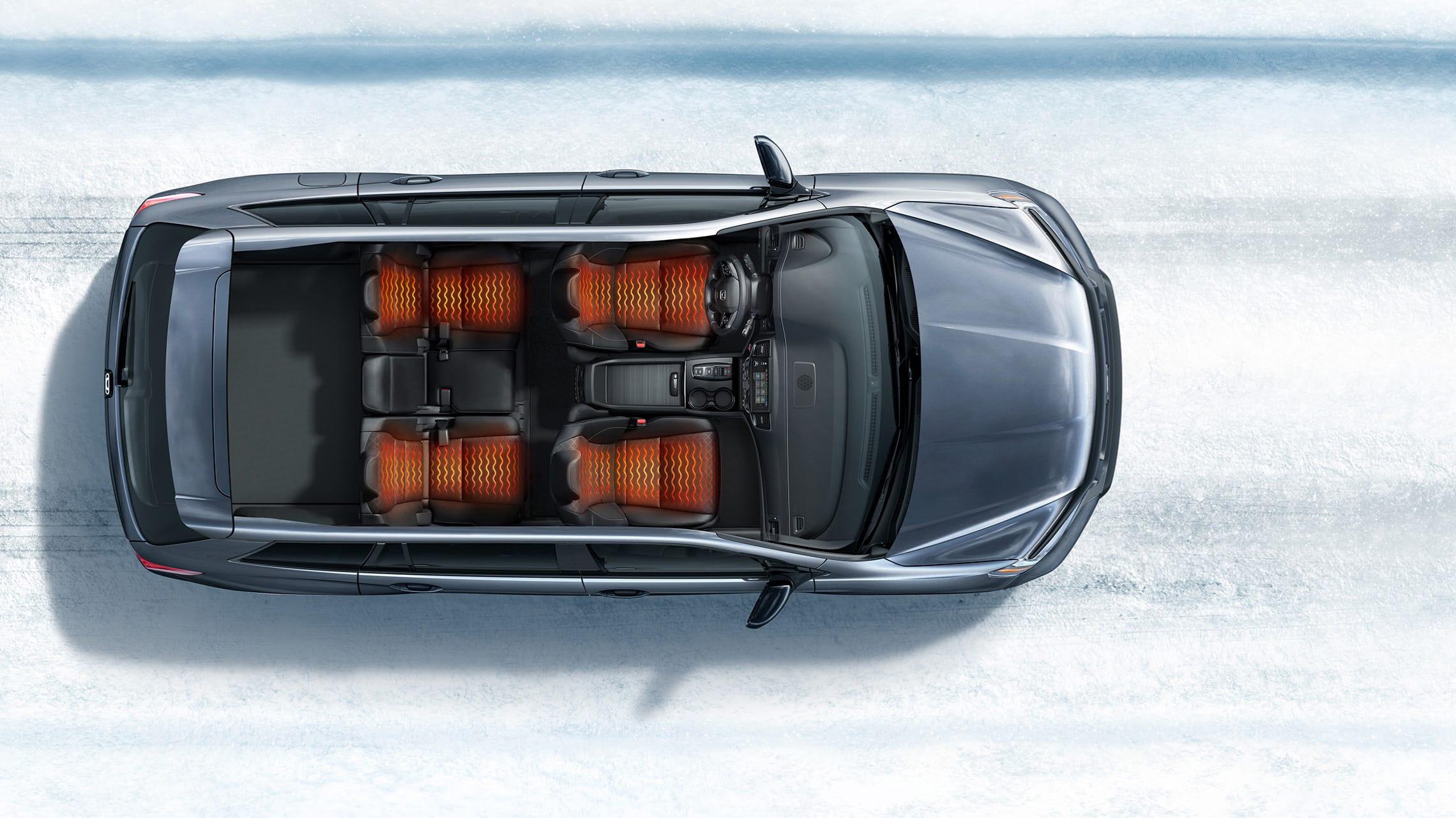 Vista aérea de la Honda Passport Elite2020 que muestra asientos calefaccionados en un entorno de caminos nevados.
