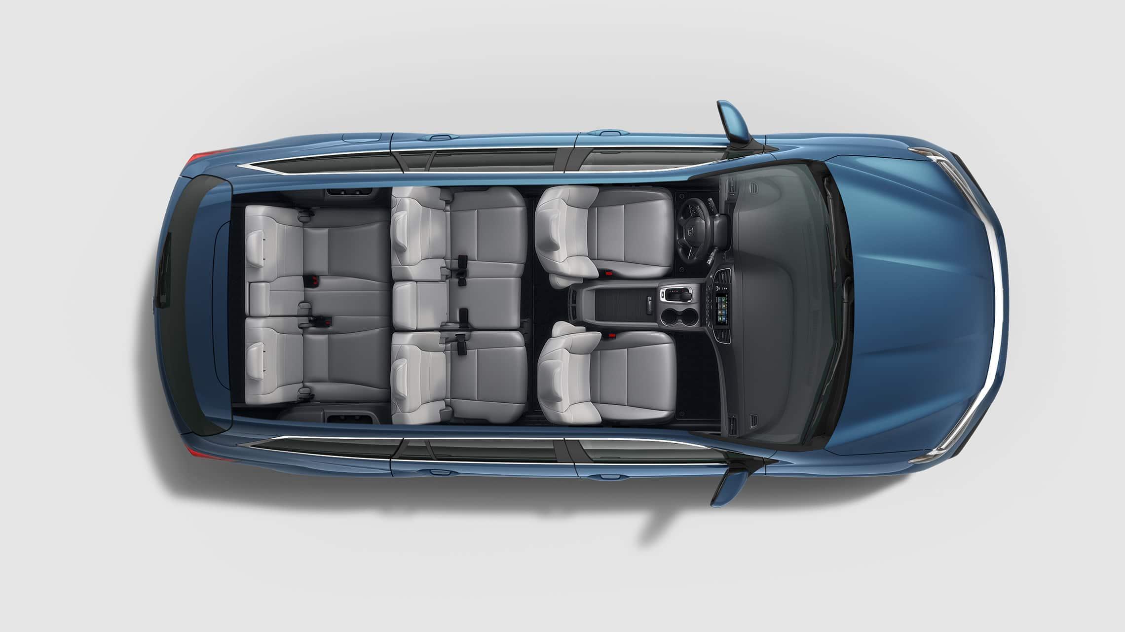 Vista aérea de la Honda Pilot Elite2020 en Steel Sapphire Metallic con configuraciones de asientos.